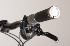Bike grip of mountain bike, close up view, studio photo. Bike grip of mountain bike, close up view, studio photo Stock Photos