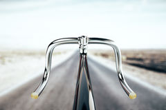 Bike handlebar, travel concept. Close up of black bike handlebar on road backgrpound. Travel concept. 3D Rendering Royalty Free Stock Photos