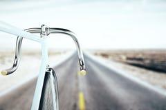 Bike handlebar, travel concept. Close up of bike handlebar on blurry road backgrpound. Travel concept. 3D Rendering Royalty Free Stock Images