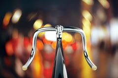 Bike handlebar, travel concept. Close up of bike handlebar on bokeh backgrpound. Travel concept. 3D Rendering Stock Image