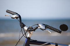 Bike handlebar wheel over see horizon Royalty Free Stock Image