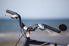Bike handlebar wheel over see horizon Royalty Free Stock Image