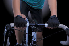 Bike handlebars with hands of female athlete Stock Images
