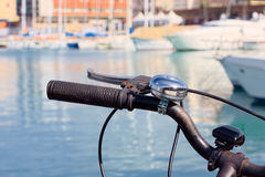 Bike with the handlebars out , parked in a port of Livorno , with many boats as background. Royalty Free Stock Photography