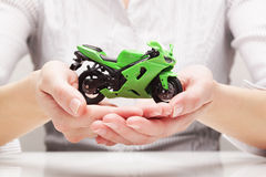 Bike in hands (concept) Stock Photos