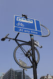 Bike hanging off a sign post. A bike I found in London that was handing off a sign post by its handle bars and the bottom wheel was secured with a lock to the Royalty Free Stock Photos