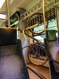 Bike hanging on the rack in the train. Providing bicycle lover an alternative to travel on public transit. Connect metro rail to work, school, shopping Royalty Free Stock Photos