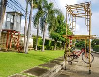The bike hanging on the scaffolding In the countryside village royalty free stock images