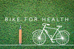 Bike for health drawing on grass background Royalty Free Stock Photography