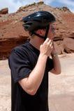 Bike helmet. Man putting on a bike helmet Royalty Free Stock Photos