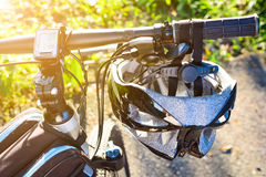 Bike helmet and bike on the street. And evening sun Royalty Free Stock Photo