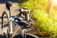 Bike helmet and bike on the street. And evening sun Royalty Free Stock Photography