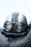 Motorcycle safety helmet. Closeup of an bike helmet with windproof glasses on a Cruiser motorcycle seat Stock Photos