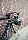 Bike helmet on race road cycle Stock Photos