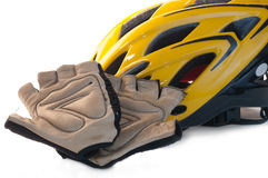 Bike Helmet and Riding Gloves. Worn fingerless riding gloves and yellow bike helmet isolated on white Stock Photography