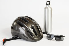 Bike helmet sunglasses and metal water flask Stock Photo