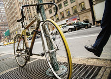Bike hitched on street sign. A bamboo frame bike hitched on a street sign in a city Stock Images