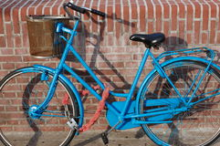 Bike in Holland. A blue bike in Holland with a wall Royalty Free Stock Images