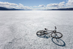 Bike on Ice. Bicycle on ice surface of huge frozen Lake Laberge, Yukon T, Canada, in April Stock Photo