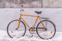Bike insulated knitted garment decorated on a snowy street.  Stock Photo