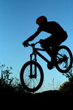 Bike jump silhouette. Silhouette of a man doing a mountain bike jump Royalty Free Stock Images
