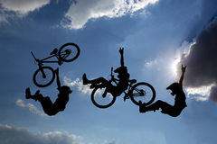 Bike jump silhouettes multiple exposure Stock Photography