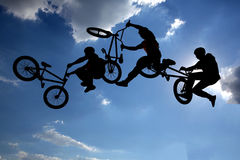 Bike jump silhouettes multiple exposure Royalty Free Stock Images