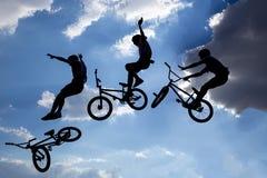 Bike jump silhouettes multiple exposure Stock Image