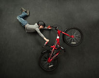 Bike jump. Young boy is performing an extreme bike jump stock images