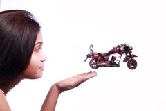 Bike Jumping from womans hand Stock Photos