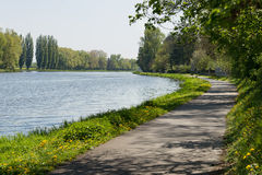 Bike lane bicycle cycle path by the river green trees EU supported project Stock Photography