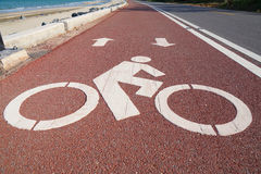 Bike lane or bicycle path and coastal road in Thailand Royalty Free Stock Images