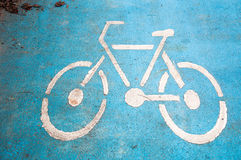 the bike lane on blue road  for bicycle or biker Royalty Free Stock Image