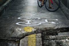 Bike lane broken and crack very danger. Bike lane broken and crack endangering Royalty Free Stock Image