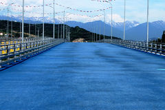Bike Lane. Cycle track with bright blue coating on the background of mountain peaks in Sochi Park Stock Image