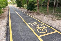 Bicycle lane in the park. A bike lane for cyclist. Bicycle lane in the park Stock Image