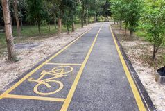Bicycle lane in the park. A bike lane for cyclist. Bicycle lane in the park Stock Photography