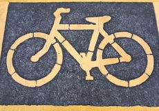 Bicycle lane in the park. A bike lane for cyclist. Bicycle lane in the park Royalty Free Stock Image