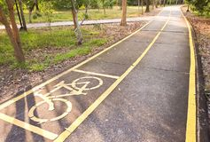 Bicycle lane in the park. A bike lane for cyclist. Bicycle lane in the park Royalty Free Stock Photos