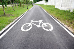 Bike lane. A bike lane for cyclist. Bicycle lane in the park Royalty Free Stock Image