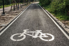 Bike lane. A bike lane for cyclist. Bicycle lane in the park Royalty Free Stock Photos
