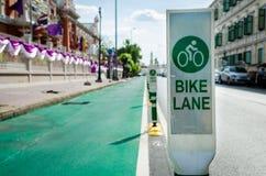 Bike lane. Green bike lane sign for safety Royalty Free Stock Images