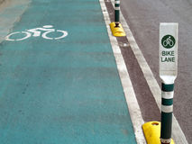 Bike lane, label and symbols cyclists on green road in Bangkok, Thailand Stock Image