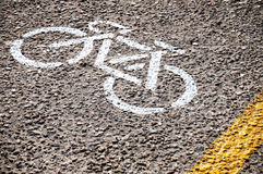 Bike Lane Markings. Painted on the Street in White and Yellow Paint Royalty Free Stock Photos