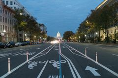Bike lane at night Washington DC. Bike lane at night in Washington DC with the capital building in the distance vanishing point perspective long boulevard shot stock photo