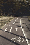 Bike lane in the park. Bicycle lane in the park with bike sign on it Royalty Free Stock Images
