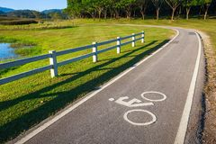 Bike Lane in Park. Bycicle lane with icon in suburb park Stock Images