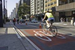 Bike lane in Paulista Avenue - São Paulo. A Bike lane in Paulista avenue, São Paulo, Brazil. At about 5 km long, the bike lane will run from 7:00am to 16 stock photo