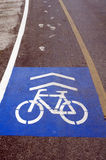 Bike lane on road. Bike symbol on the road way for bike Stock Image