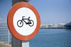 Bike lane beside the sea. Bike lane symbol on blue background beside the seaport Stock Images